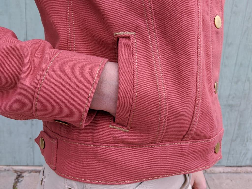 Pink denim jacket, welt pocket close up