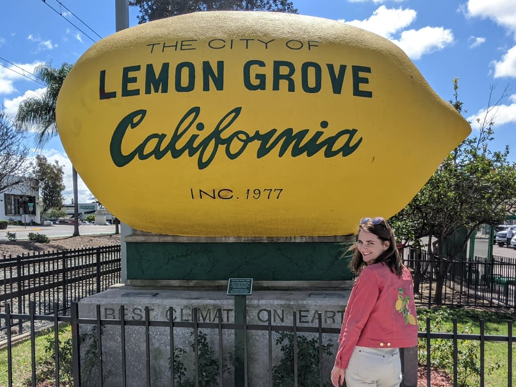 Lemon Jean Jacket in front of Lemon Grove California