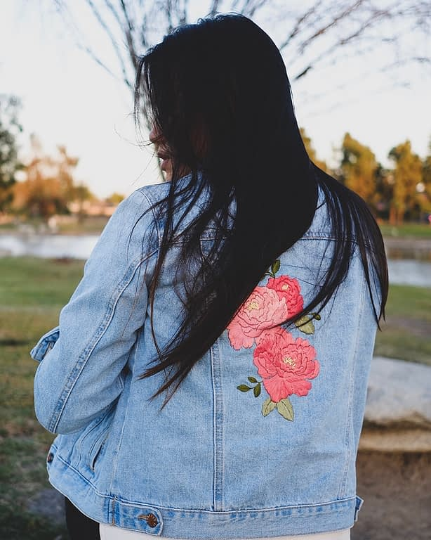 Denim jacket embroidered with floral motif by stitchinginspace