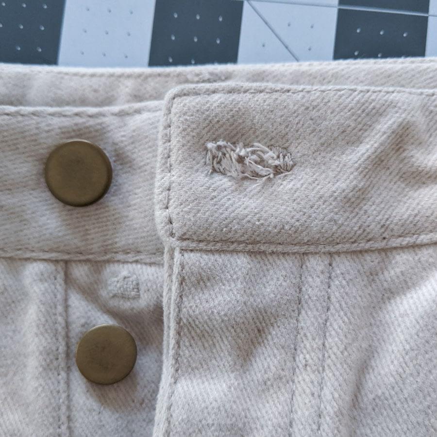 Frayed buttonhole